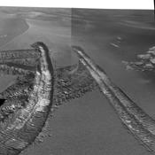 This view from the navigation camera on NASA's Mars Exploration Rover Opportunity shows tracks left by backing out of a wind-formed ripple after the rover's wheels had started to dig too deeply into the dust and sand of the ripple.