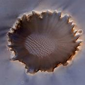 This image of Victoria Crater in the Meridiani Planum region of Mars was taken by the High Resolution Imaging Science Experiment (HiRISE) camera on NASA's Mars Reconnaissance Orbiter at more of a sideways angle than earlier orbital images of this crater.