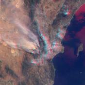NASA's Terra satellite took this anaglyph of several pyrocumulus clouds, created by the Station Fire, visible above the smoke plumes rising from the San Gabriel Mountains north of Los Angeles.