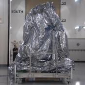 NASA's Wide-field Infrared Survey Explorer spacecraft sits with its protective covering.