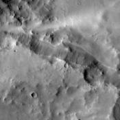Dark slope streaks abound in this image taken by NASA's 2001 Mars Odyssey spacecraft. The unnamed craters in this image are located east of Henry Crater.