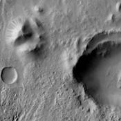 NASA's 2001 Mars Odyssey spacecraft captured numerous dark slope streaks in this small unnamed crater in Zephyria Planum.