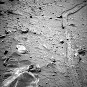 This view from the navigation camera near the top of the mast on NASA's Mars Exploration Rover Spirit shows the tracks left by the rover as it drove southward and backward, dragging its inoperable right-front wheel.