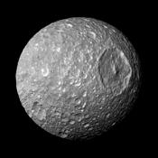 In this view captured by NASA's Cassini spacecraft on its closest-ever flyby of Saturn's moon Mimas, large Herschel Crater dominates Mimas, making the moon look like the Death Star in the movie 'Star Wars.'