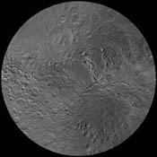 The northern hemisphere of Saturn's moon Rhea is seen in this polar stereographic map, mosaicked from the best-available images obtained by NASA's Cassini and Voyager spacecraft.