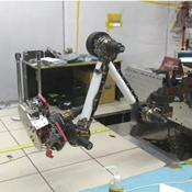 In this image, engineers from NASA's Jet Propulsion Laboratory test and 'flex' Curiosity's robotic arm and tools. A video can be viewed at the Photojournal.