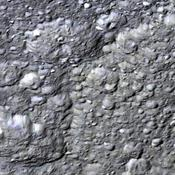 This perspective view from NASA's Cassini orbiter shows the western half of Rhea's second largest impact basin, Tirawa. The broad arcuate scarp cutting across scene center is the battered rim of Tirawa.