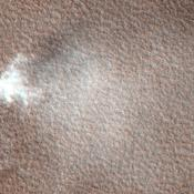 This image from NASA's Mars Reconnaissance Orbiter was targeted to study knobs in Mars' northern plains, north of Scandia Crater. The knobs are clearly imaged, but what surprised scientists was a dust devil visible in the south-central part of the image.
