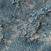 This image taken by NASA's Mars Reconnaissance Orbiter covers part of a candidate landing site that appears to be a shallow depression with a deposit perhaps consisting of chlorides, like table salt.