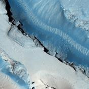 This image taken by NASA's Mars Reconnaissance Orbiter shows part of Cerberus Fossae, a long system of extensional (normal) faults arranged in trough-bounding (graben-bounding) pairs.