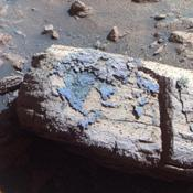 This false color image from the panoramic camera on NASA's Mars Exploration Rover Opportunity shows a rock called 'Chocolate Hills,' which the rover found and examined at the edge of a young crater called 'Concepción.'