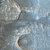 The terrain in this image from NASA's Mars Reconnaissance Orbiter lies in the Deuteronilus Mensae region along the highland-lowland dichotomy boundary in the northern hemisphere of Mars.