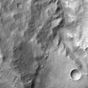 This image of Terra Cimmeria taken by NASA's 2001 Mars Odyssey shows channeling and dunes near Herschel Crater.