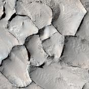 This image captured by NASA's Mars Reconnaissance Orbiter from the Gordii Dorsum region of Mars shows a large area covered with polygonal ridges in an almost geometric pattern.