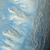 This image from NASA's Mars Reconnaissance Orbiter shows the west-facing side of an impact crater in the mid-latitudes of Mars' northern hemisphere. This crater has gullies along its walls that are composed of alcoves, channels and debris aprons.