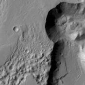 This image of part of Chryse Chaos shows landslide deposits at the head of the canyon. Chryse Chaos is part of a huge outflow channel on Mars. NASA's 2001 Mars Odyssey captured this image on May 6, 2010.