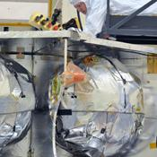 Technicians installed the special radiation vault for NASA's Juno spacecraft on the propulsion module. The radiation vault has titanium walls to protect the spacecraft's electronic brain and heart from Jupiter's harsh radiation environment.