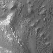 This image from NASA's Mars Odyssey shows part of the floor of Ganges Chasma. Deposits of fine surface materials and bright layered deposits are visible in this image.
