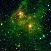 Two extremely bright stars illuminate a greenish mist in this image from the new