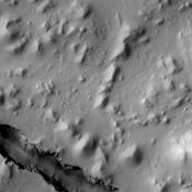 One of the tectonic fractures of Cerberus Fossae is visible at the bottom of this image taken by NASA's Mars Odyssey on June 25, 2010.