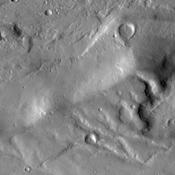 Large fractures have formed 'steps' in this region of Tempe Terra as seen by NASA's Mars Odyssey.