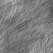 Many surface lava flows on the flanks of Olympus Mons are confined to narrow channels, like the ones in today's image from NASA's Mars Odyssey.