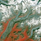Folds in the lower reaches of valley glaciers can be caused by powerful surges of tributary ice streams. This phenomenon is spectacularly displayed by the Sustina Glacier in the Alaska Range as seen by NASA's Terra spacecraft.