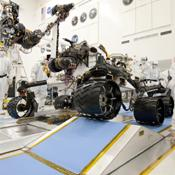 NASA's next Mars rover, Curiosity, drives up a ramp during a test at NASA's Jet Propulsion Laboratory, Pasadena, Calif. The rover, like its smaller predecessors already on Mars, uses a rocker bogie suspension system to drive over uneven ground.