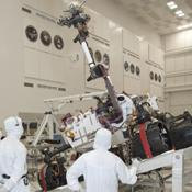NASA's next Mars rover, Curiosity, stretches its robotic arm upward during tests on a tilt table in a clean room at NASA's Jet Propulsion Labotatory.