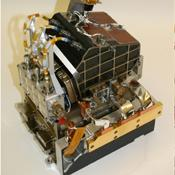 The two main parts of the ChemCam laser instrument for NASA's Mars Science Laboratory mission are shown in this combined image.