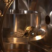 The ChemCam instrument for NASA's Mars Science Laboratory mission uses a pulsed laser beam to vaporize a pinhead-size target, producing a flash of light from the ionized material (plasma) that can be analyzed to identify chemical elements in the target.