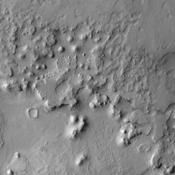 The ejecta blanket created around impact craters is often much more resistant to erosion than surrounding surface materials. As seen by NASA's Mars Odyssey, the ejecta material creates isolated highs as surrounding surface is eroded near Meridiani Planum.