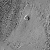 The action of the wind continues to shape the surface of Mars. This region has been eroded by the wind into parallel hills. This image from NASA's Mars Odyssey was captured on Sept. 6, 2010.