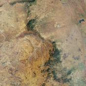 This nadir camera view was captured by NASA's Terra spacecraft around Kruger National Park in NE South Africa. The bright white feature is the Palabora Copper Mine, and the water body near upper right is Lake Massingir in Mozambique.