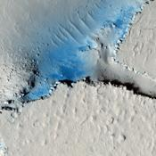 This observation from NASA's Mars Reconnaissance Orbiter shows fractured mounds on the southern edge of Elysium Planitia. The fractures that crisscross their surfaces are probably composed of solidified lava.