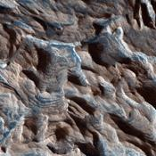 This observation from NASA's Mars Reconnaissance Orbiter shows Becquerel Crater, one of several impact craters in Arabia Terra that have light-toned layered deposits along the crater floor. The layers appear to be only a few meters thick.