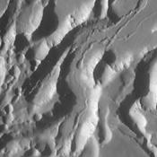Arsia Chasmata is a complex collapsed region at the northeastern flank of Arsia Mons. The collapsed region aligns with the Pavonis and Ascraeus Mons volcanoes, indicating that all three volcanoes are located on a major fracture in the Tharsis region.