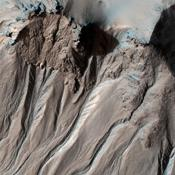 This image from NASA's Mars Reconnaissance Orbiter shows the southern latitude Hale Crater, a rather large, pristine elliptical crater possessing sharp features, impact melt bodies ponded throughout the structure and few overprinting impact craters.