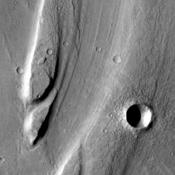 The streamlined islands in this image from NASA's Mars Odyssey are located in Maja Valles.