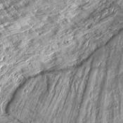This image from NASA's Mars Odyssey shows a small portion of two landslide deposits within Melas Chasma.