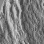 Located to the northeast of Olympus Mons, Cyane Sulci is a complexly fractured region of material inundated on its margins by volcanic flows. This image was captured by NASA's Mars Odyssey on Oct. 24, 2010.