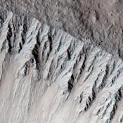 This image from NASA's Mars Reconnaissance Orbiter is one of the rare examples of a fresh 'lunar-like' crater on Mars. The impact crater formed in the Tharsis region.