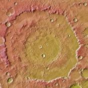 This image from NASA's Mars Global Surveyor and Mars Odyssey spacecraft shows the context for orbital observations of exposed rocks that had been buried on Mars. The area is dominated by the Huygens crater, which is about the size of Wisconsin.