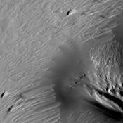 Constant sand-blasting by the winds on Mars have eroded and sculpted the surface in the equatorial region around Medusae Fossae in this image captured by NASA's Mars Odyssey.