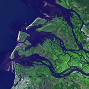 NASA's Terra spacecraft captured this image of the city of Arkhangelsk (or Archangel in English) and administrative capital of Archangelsk Oblast, Russia. It is situated on both banks of the Dvina River near where it flows into the White Sea.