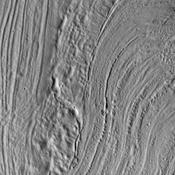 This unusual surface texture is found on the northwest part of Olympus Mons as seen by NASA's Mars Odyssey. The origin of this texture is unknown, but speculations include glacial or volatile rich materials as part of the cause of such textures.