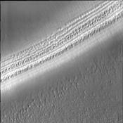 This image captured by NASA's Mars Odyssey shows the layers of a polar trough and several different surface textures.