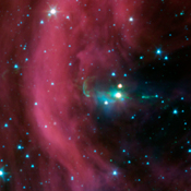 NASA's Spitzer Space Telescope took this image of a baby star sprouting two identical jets (green lines emanating from fuzzy star). The left jet was hidden behind a dark cloud, which Spitzer can see through.