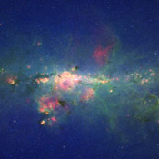 A view from the bustling center of our galactic metropolis. NASA's Spitzer Space Telescope offers a fresh, infrared view of the frenzied scene at the center of our Milky Way, revealing what lies behind the dust.