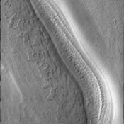 This image from NASA's Mars Odyssey is of 'swiss cheese' terrain. Sometimes simple terms like these can accurately describe the appearance of a surface, but it does not relate at all to how that surface texture may have formed.